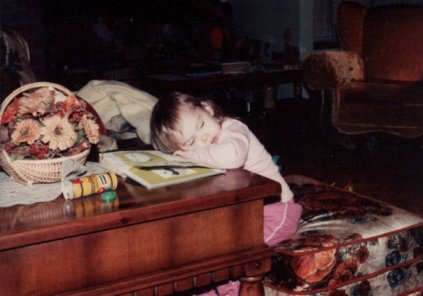 Me, passed out on my Robber Raccoon book. Based on the house, I was no more than just over 3 years old in this picture.