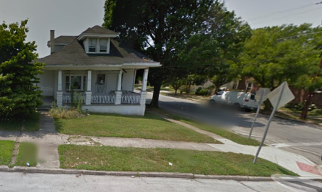 The little white house on the corner, via Google Maps.